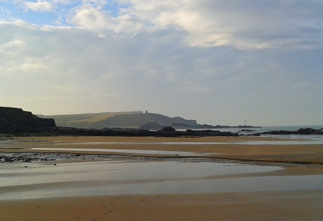 Across the beach to Bude Breakwater